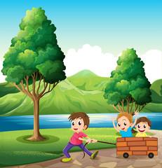 Boys playing at the riverbank