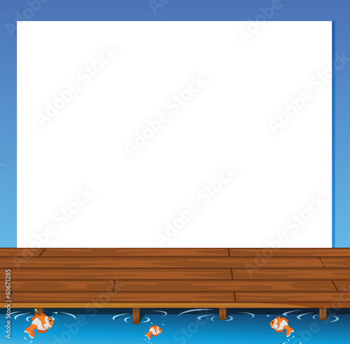 An empty paper template with a wooden bridge and fishes at the b
