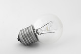 Light bulb in natural light on white background