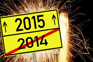 Sektflasche mit Feuerwerk und Schild 2015