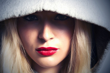 Beautiful Blond Woman in Hood.Red Lips.Box.Close-up