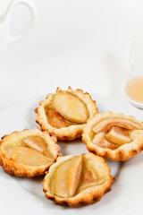 Simple tartlets with poached pear and syrup