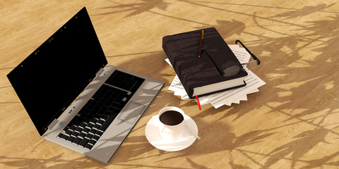 book  coffee and computer on wood floor