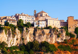 Day picturesque view of houses on rock in Cuenca