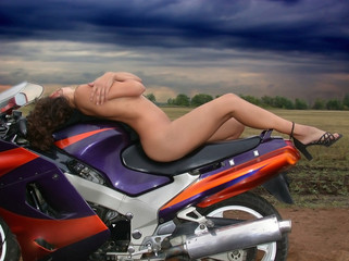 Beautiful naked girl on a motorcycle.
