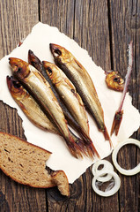 Smoked fish on wooden table