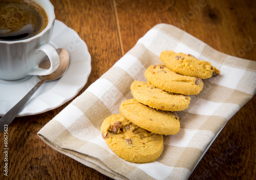 cup of coffee with butter biscuits with chocolate chips