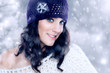 Beautiful young woman with knitted hat