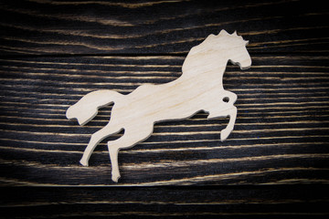 Horse on old wood background