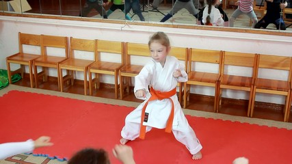Small girl beat direct blow hand in the rack karate