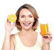 Portrait of a beautiful young woman with a glass of juice.