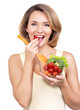 Beautiful young healthy woman eating a salad.