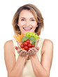 Portrait of a young smiling woman with a plate of vegetables.