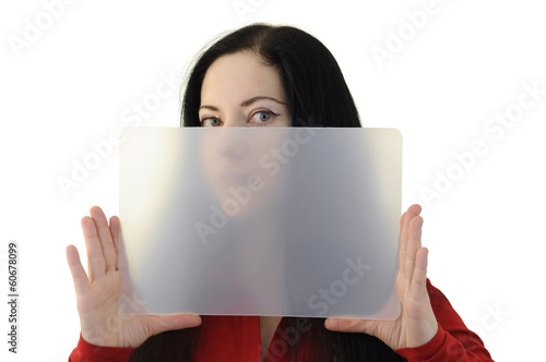 Woman in red holding a transparent plate half hiding her face