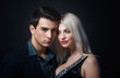 Portrait of a handsome young couple on dark background