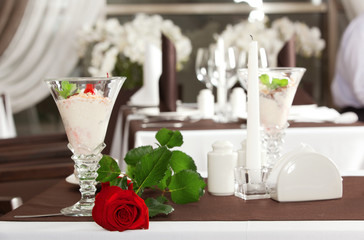ice cream and red rose on decorated table