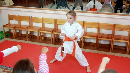 Girl athlete before the children beat blow hand