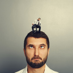 foolish man with small bored man on the head