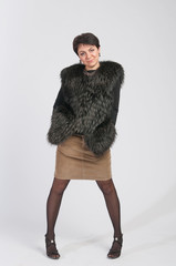 Beautiful Woman in Luxury Fur Coat. Fashion model