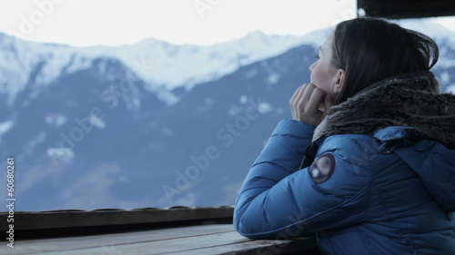 Woman in the mountains looking at beautiful view