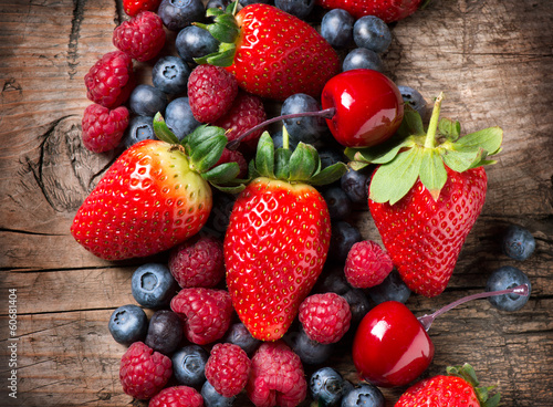 Berries on Wooden Background. Spring Organic Berry