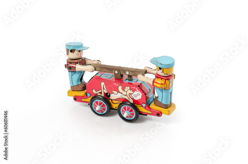 Vintage old tin toy  made of tin isolated on white.clipping path