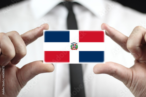 Businessman holding a business card with Dominican Republic Flag