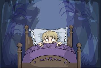 boy in bed having nightmares