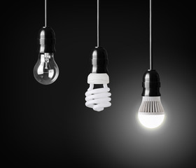 Light bulb,energy saver bulb and LED bulb on black