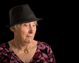 Senior lady with a shocked look on her face wearing a fedora