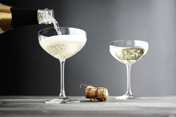 Champagne being filled in Coupe Glasses