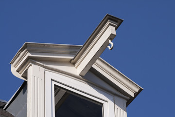 White dormer on a blue sky.