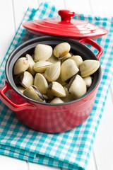 raw clams in pot