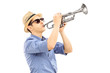 Young male musician playing trumpet