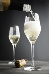 Champagne being filled into Glasses