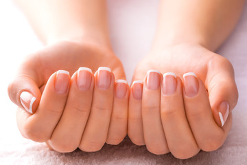 french manicure on the white towel