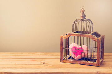Valentine's day background with bird cage and heart shape