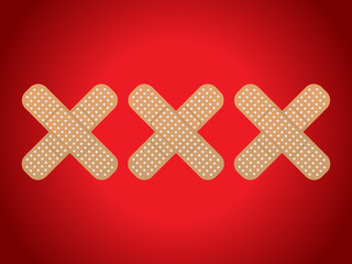 XXX shaped plasters on red background