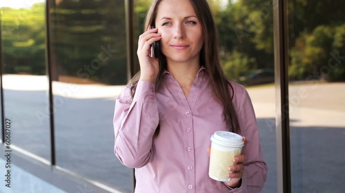 Cheerful businesswoman talking on the phone