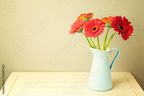 Gerbera daisy flowers on wooden white table