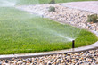 canvas print picture - Sprinklers watering grass