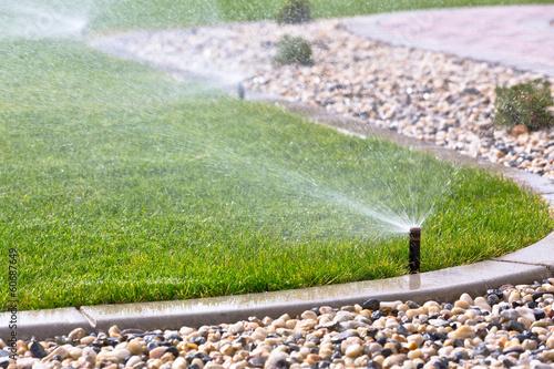 Leinwanddruck Bild Sprinklers watering grass