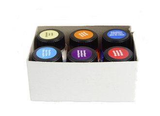 A set of water based acrylic paint in a box on white background