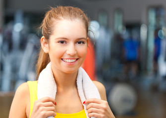 Young woman smiling in a fitness club