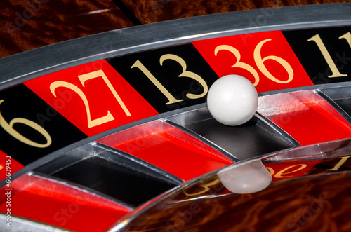 Classic casino roulette wheel with black sector thirteen 13
