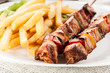 Grilled shashlik with chips