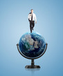 man walking on globe