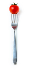 little tomato on fork