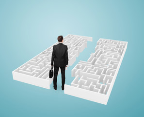 businessman  looking at maze