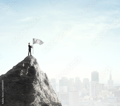 businessman standing with flag